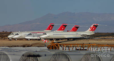A Row Of Dc-9's Silently Await Their Final Demise Art Print by Wernher Krutein