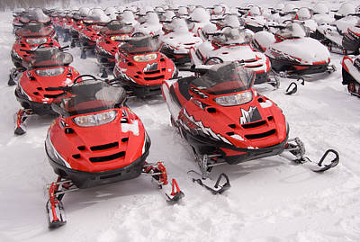 A Row Of Snowmobiles Sit Waiting Print by Taylor S. Kennedy