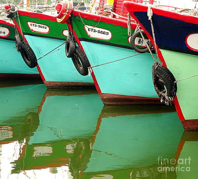 Photograph - A Row Of Traditional Fishing Boats by Yali Shi