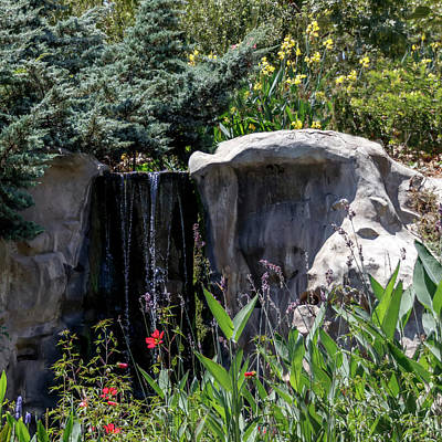 Thomas Kinkade - A small artificial waterfall between large stones by Emma Grimberg