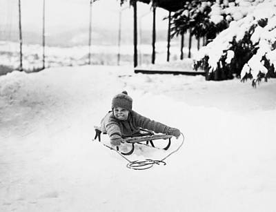 A Small Child On A Sled  Art Print by American School