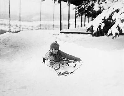 A Small Girl On A Sled Art Print by Underwood Archives