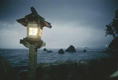 A Small Wooden Lantern Looks Art Print by Luis Marden
