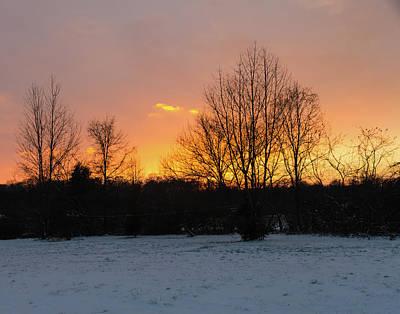 Photograph - A Snowy Sunset by Steve Atkinson