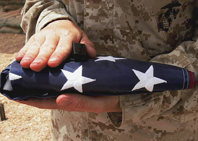 A Soldier Holds The United States Flag Art Print by Stocktrek Images
