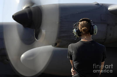 C-130 Wall Art - Photograph - A Soldier Monitors The Performance by Stocktrek Images