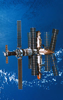 Space Ships Photograph - A Space Station Orbiting In Space by Stockbyte