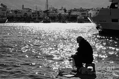 Photograph - A Sparkling Fisherman by Konstantinos Chatziamallos