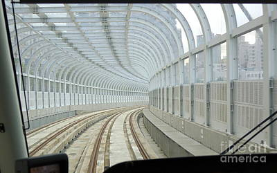 Photograph - A Streetcar Moves Drives On A Covered Track by Yali Shi