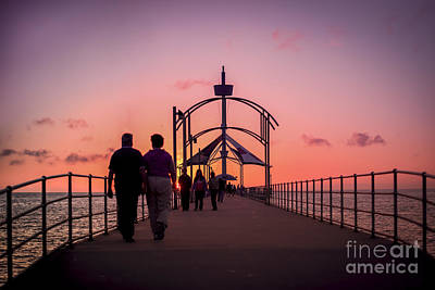 A Stroll Along Sunset Pier Art Print