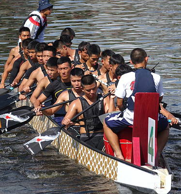 Photograph - A Team Of Navy Sailors Prepares For The Dragon Boat Races by Yali Shi