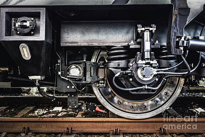 Metal Photograph - A Train Wheel Close-up. Railway Industry by Michal Bednarek