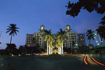 A Twilight View Of Building With Palm Art Print by Steve Winter