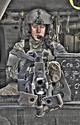 Camp Speicher Photograph - A Uh-60 Black Hawk Door Gunner Manning by Terry Moore