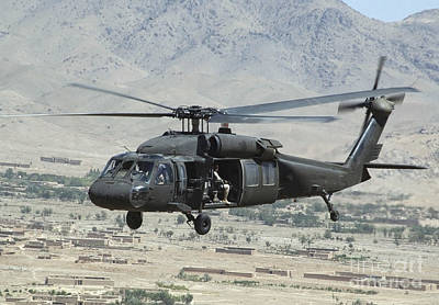 Middle East Photograph - A Uh-60 Blackhawk Helicopter by Stocktrek Images