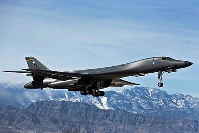 Lancer Photograph - A U.s. Air Force B-1b Lancer Departs by Stocktrek Images