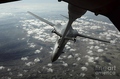 A U.s. Air Force Kc-10 Refuels A B-1b Art Print by Stocktrek Images