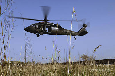 Photograph - A U.s. Army Uh-60 Black Hawk Helicopter by Stocktrek Images
