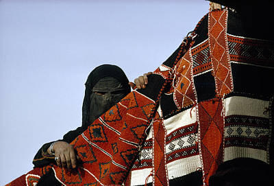 Oppression Photograph - A Veiled Bedouin Woman Peers by Thomas J Abercrombie