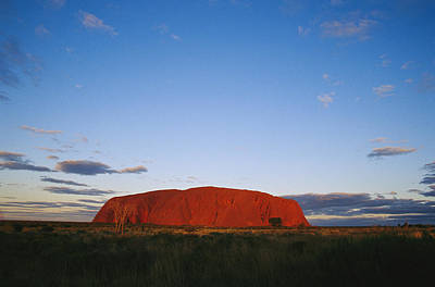 Ayers Rock Photograph - A View Of Ayers Rock Under A Twilight by Jason Edwards