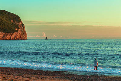 A Summer Evening Photograph - A Warm Summer Evening A Woman Admires A Calm Sea And Setting Sun by George Westermak