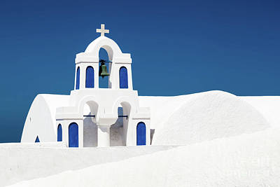 Resort Photograph - A White Church With Blue Elements In Oia On Santorini Island, Greece. by Michal Bednarek