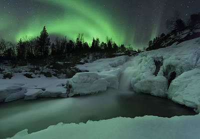 A Wintery Waterfall And Aurora Borealis Art Print by Arild Heitmann