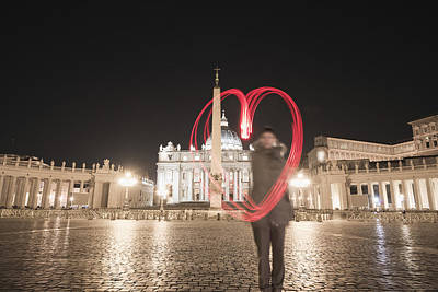 Piazza San Pietro Photograph - A Woman Stands With A Red Light Trail by Mats Silvan
