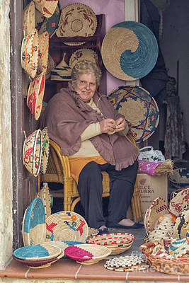 Photograph - A Woman Weaving Baskets In Castelsardo by Patricia Hofmeester