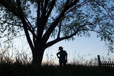 Cowboy Hat Photograph - A Young Boy Is Silhouetted by Joel Sartore