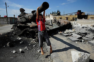 A Young Syrian Boy Plays On The Turret Art Print by Andrew Chittock