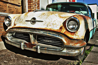 Photograph - Abandoned Old Oldsmobile by Tatiana Travelways