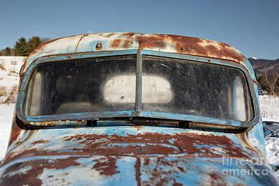 Photograph - Abandoned Truck In Snowy Field by Edward Fielding
