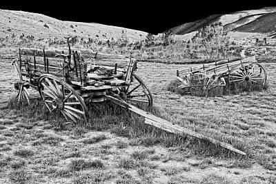 Miners Ghost Photograph - Abandoned Wagons Of Bannack Montana Ghost Town by Daniel Hagerman