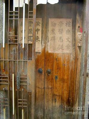 Abandoned Wooden Door With Gate Art Print by Kathy Daxon