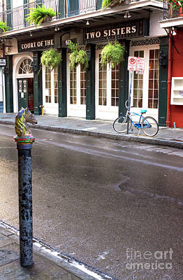 Across The Street In The French Quarter Art Print by John Rizzuto