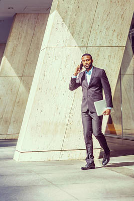 Photograph - African American Businessman Talking On Cell Phone, Walking Out After Work 17052112 by Alexander Image