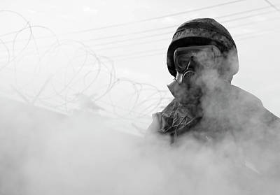 Photograph - Airman Assists With Decontamination Operations by Paul Fearn