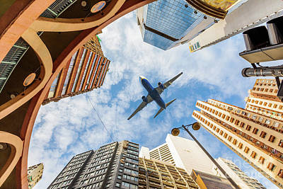 Photograph - Airplane Above City by Benny Marty