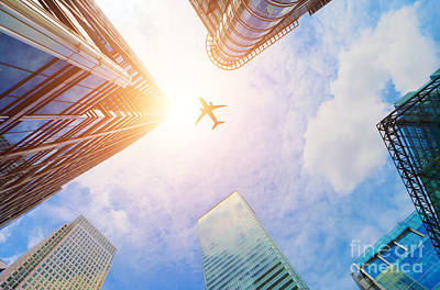 Aviation Photograph - Airplane Flying Over Modern Business Skyscrapers by Michal Bednarek