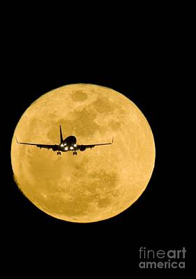 Photograph - Airplane Silhouetted Against A Full Moon by David Nunuk SPL