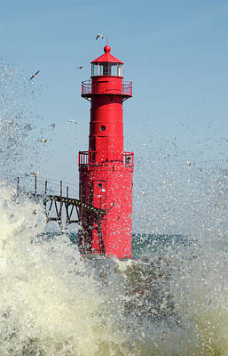 Photograph - Algoma Lighthouse _ Splashed By A Wave by Janice Adomeit