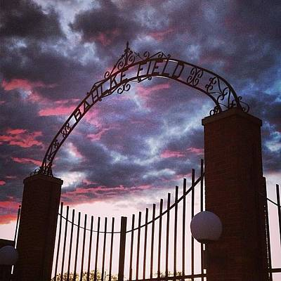 Photograph - Alma College Bahlke Field Gates Clouds by Chris Brown