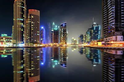 Photograph - Amazing Night Dubai Marina Skyline With Skyscrapers And Beautiful Water Reflection, Dubai, United Arab Emirates by Marek Kijevsky