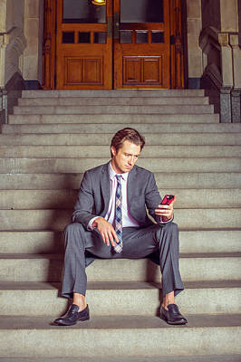 Photograph - American Businessman Texting On Cell Phone, Sitting On Stairs by Alexander Image