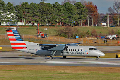 Photograph - American Eagle Dash 8 N337en A by Joseph C Hinson Photography