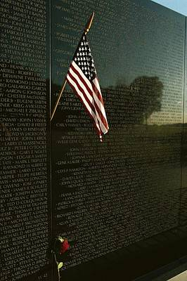 War Monuments And Shrines Photograph - American Flag Left At The Vietnam by Medford Taylor