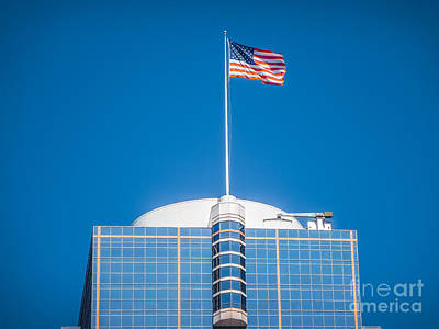 Photograph - American Flag Waving On Top Of A Modern Skyscraper by JR Photography