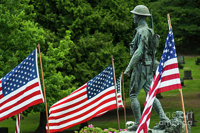 Photograph - American Flags At Cemetery With Soldier Sculpture by Jim Corwin
