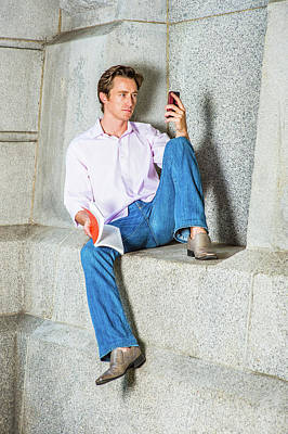 Photograph - American Man Reading Book, Texting On Cell Phone Outside. by Alexander Image